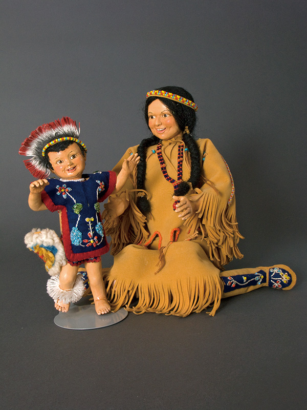 Chippewa Mother and Child Wax over porcelain, leather and cloth