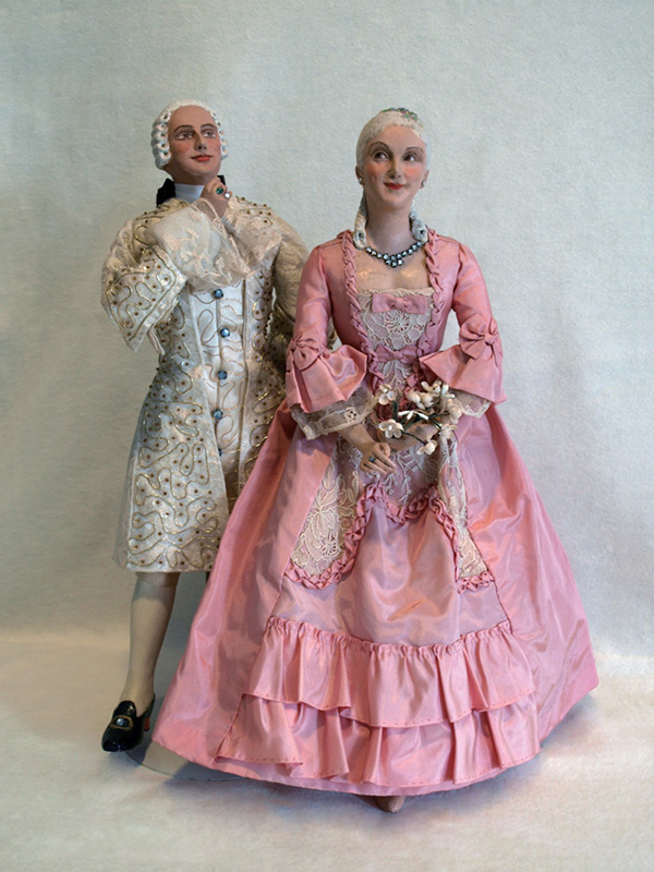 Early pair, man and woman  paper mache