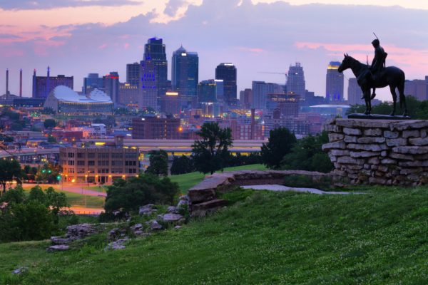 View of Kansas City, Missouri skyline at dawn during golden light from the Kansas City Scout Memorial with all registered trademarks removed.